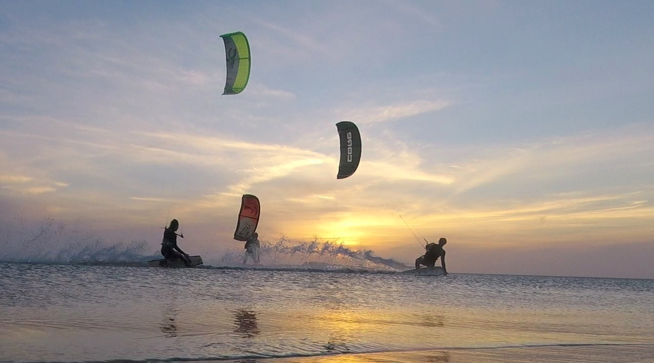 Kitesurfing in the sunset with friends
